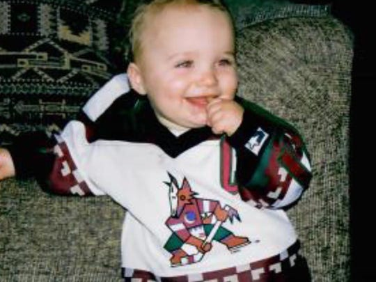 A young Matthew Tkachuk wears a Coyotes jersey.