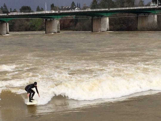 Anders Handorg, 26, of Huntington Beach, surfs waves