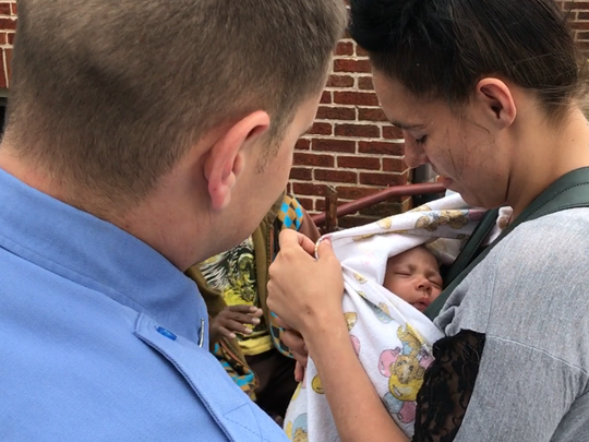 Knoxville Fire Department Senior Firefighter Eric 'Bo' Merritt checks in on 1-month-old Josiah a day after he caught the child, who was dropped from a third-floor window in a desperate attempt to save the baby during an East Knoxville apartment fire Sunday, April 23, 12017.