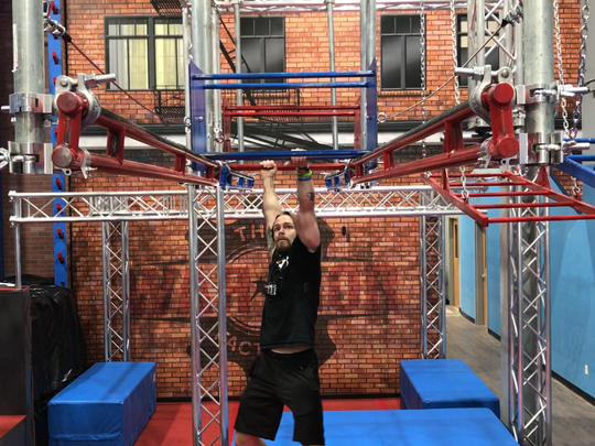 """Danny Adair, who has competed on """"America Ninja Warrior"""" tackles the obstacles at The Warrior Factory in Henrietta."""