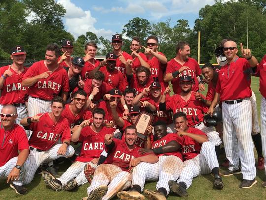 The William Carey baseball team celebrates its walk-off