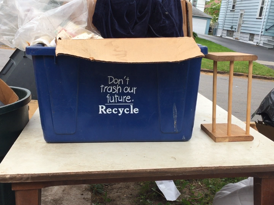 This recycle box was left with piles of trash when the resident moved out and brought junk to the curb several days before trash pickup.