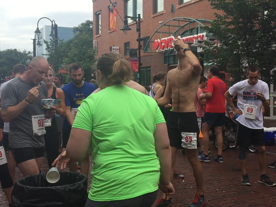 Runners down ice cream in the middle of the Brain Freezer 5k in Burlington on July 8, 2017