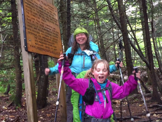 Zella Upton, 9, and her mom Yarrow cheer upon finishing