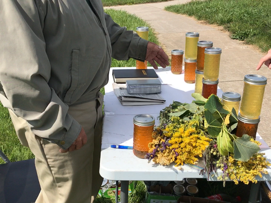 Shtengrat speaks to a resident who stopped by his honey