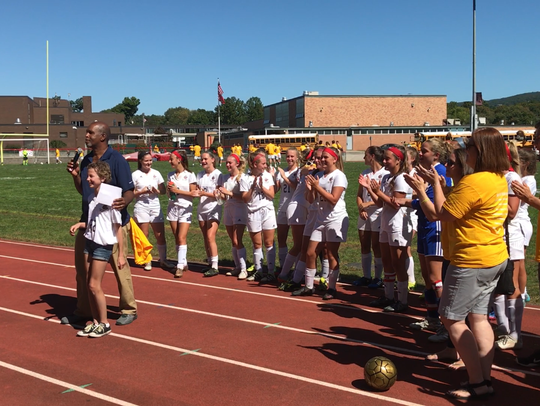 Hannah Boorse, pediatric cancer survivor, stands with
