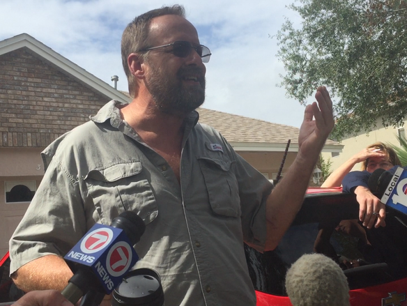 Eric Paddock talks to reporters outside his East Orlando