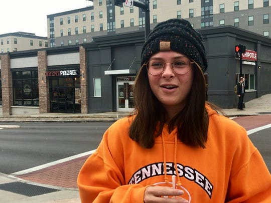 University of Tennessee freshman Story Robey talks with the media about the firing of UT's head football coach, Butch Jones, on Cumberland Avenue on Sunday, Nov. 12, 2017.