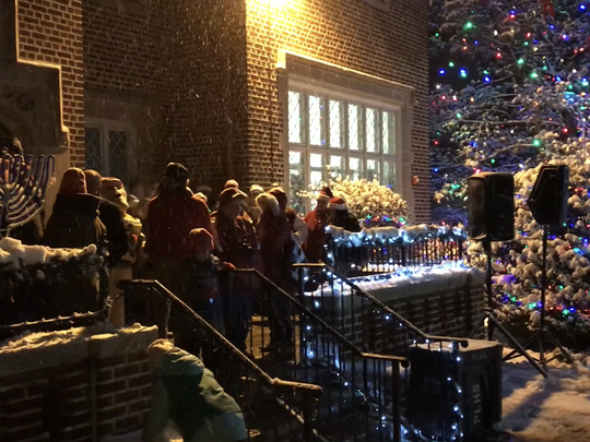 Performers in front of the library during the annual Holiday Stroll event in Pompton Lakes, N.J. on Dec. 9, 2017.