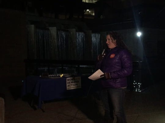 Beth Sprunger, state chapter lead for Moms Demand Action for Gun Sense in America, speaks during a vigil commemorating the fifth anniversary of the mass shooting at Sandy Hook Elementary School.
