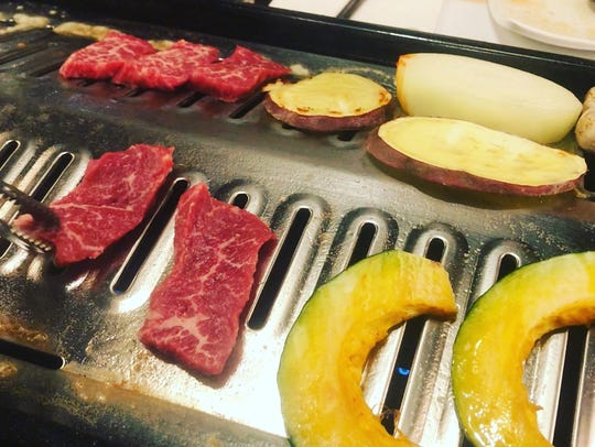 Meats and vegetables grill at at table at Suh Sushi