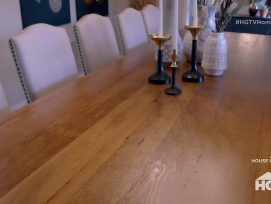A dining room table constructed in part out of old