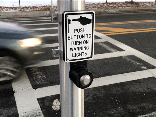Unlike nearly every traditional traffic light, the push-button on this Pedestrian Hybrid Beacon in Teaneck flashes instantly when activated.