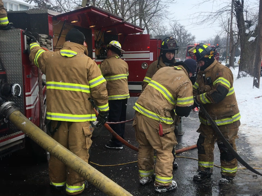 Marion City firefighters respond to a house fire on Edgewood Drive Thursday.