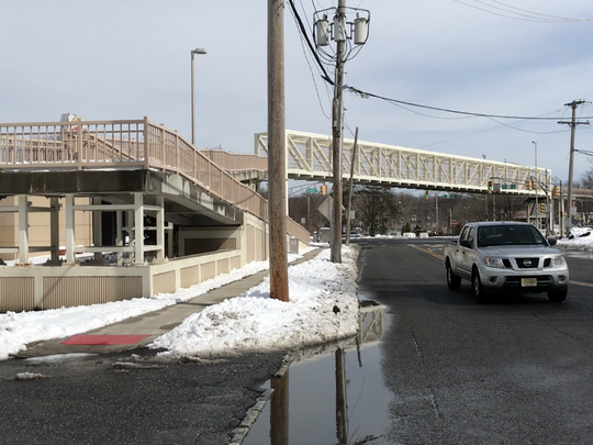 """The lengthy ramps leading to the footbridge over Route 46 in Denville led residents to dub it the """"White Monstrosity,"""" but police say it has kept pedestrians from illegally crossing the busy highway."""