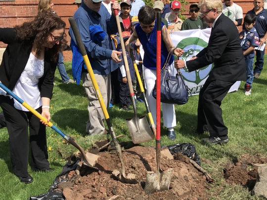 Sons and daughters of the late Marianne Coston participate in a ceremonial tree planting dedication at borough hall in Rutherford on April 28, 2018.