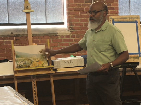 Dwight Rose teaches a class in watercolors at the Greenville