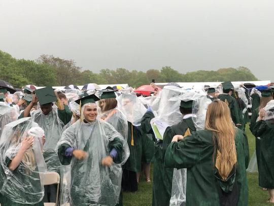 Hundreds of graduates threw on ponchos before receiving their diplomas from Raritan Valley Community College on Saturday, May 12.