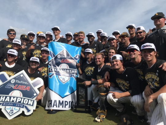 The Southern Miss baseball team poses for photos Sunday after winning the Conference USA tournament championship.