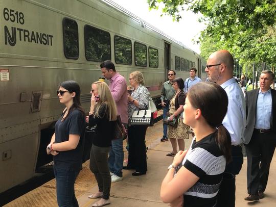 Commuters Approaching NJ Transit Train to New