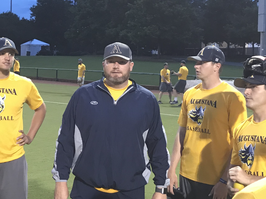 Mark Moriarty (center) has had a big impact on Augustana pitchers as the Vikings' pitching coach