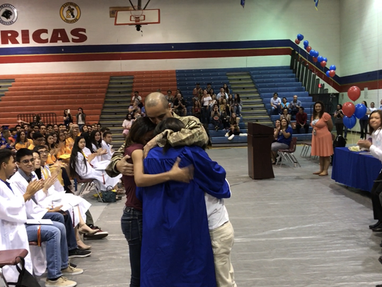 Americas High senior Tyrae Collins didn't expect her military dad, U.S. Capt. Michael Collins, to be at her school's senior assembly. He has been in Iraq for almost seven months.