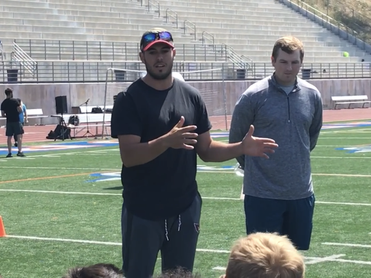 Mike Bercovici speaks to campers during the first Nelson Spruce Pro Camp at Westlake High on June 23.
