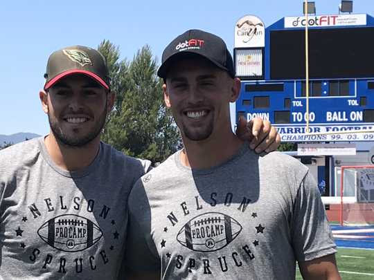 Former Westlake High teammates Mike Bercovici, left, and Nelson Spruce catch up during the first Nelson Spruce Pro Camp at Westlake High on June 23.