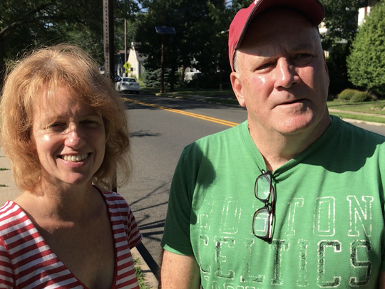 Melissa Gardner and Joe Cassidy are leading the neighborhood effort to reduce busy River Road's speed limit to 25 mph.