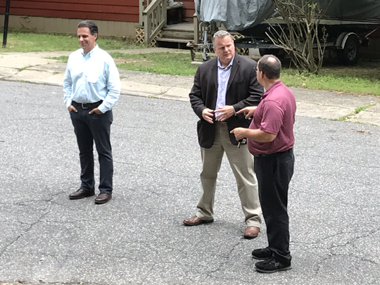 Mayor Mark Desire, middle, and Borough Administrator Michael Pappas at the scene of the High Bridge standoff on Tuesday, July 31.