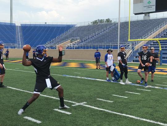Freshman quarterback J'Bore Gibbs throws toward the