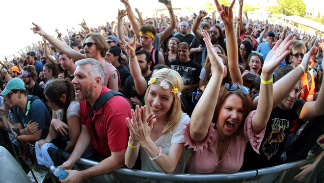 Alter Bridge fans cheer for their band on the FedEx Stage during the 41st annual Beale Street Music Festival Sunday afternoon at Tom Lee Park.