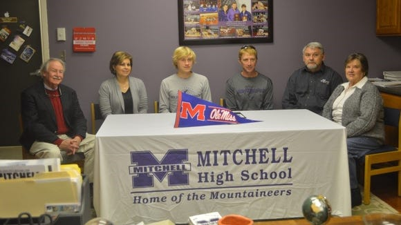 Mitchell senior Zach Boone has signed with the Mississippi cross country and track programs.