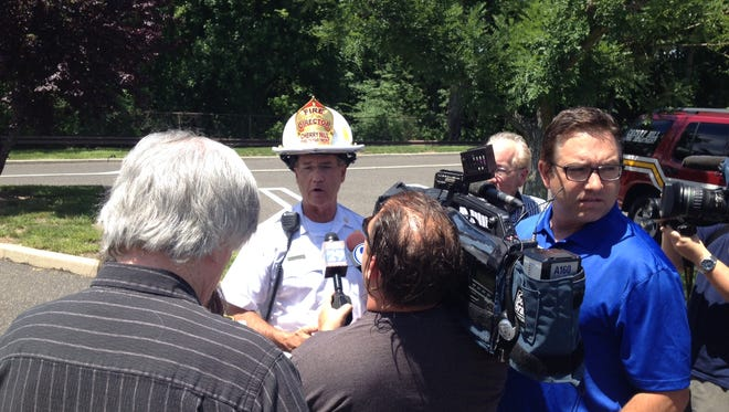 Officials give briefing after building collapse in Cherry HIll.