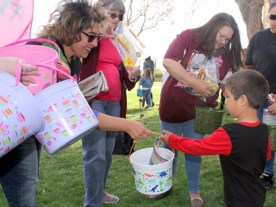 Deming Elks Lodge 2750 Lecturing Knight Yvonne Perales handed out Easter Buckets to children.