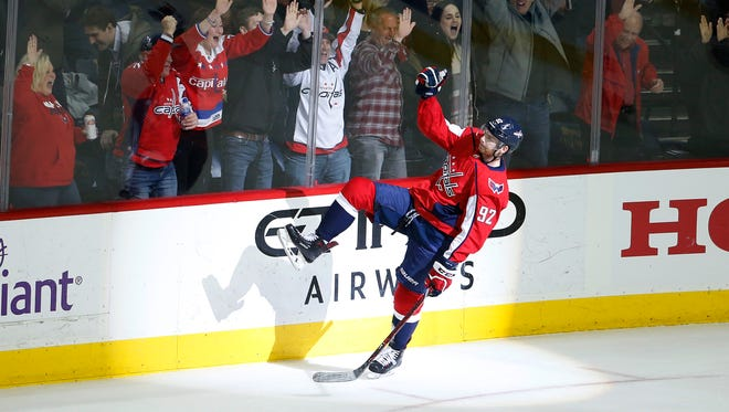 Washington Capitals center Evgeny Kuznetsov (92) celebrates after scoring the game-winning goal during overtime against the New York Rangers at Capital One Arena.