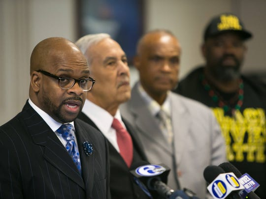 Rev. Donald Morton (left) join other local black leaders as they gather Wednesday morning at Tabernacle Full Gospel Baptist Cathedral and ask the US Department of Justice to launch a criminal investigation into the shooting death by four Wilmington police officers of 28-year-old Jeremy McDole.