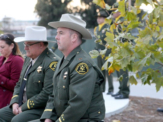 MCSO Capt. Jim Bass attends the memorial ceremony.