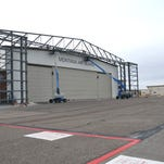 A new temporary door was added to the Main Hanger Building 25 in 2014 at the Montana Air National Guard's 120th Airlift Wing. This phase of the construction project allowed the unit's new C-130 Hercules aircraft to be maintained within an existing building.