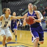 Northwestern State's Beatrice Attura drives to the basket as Stephen F. Austin's Bren?tney Branch gives chase Thursday night.