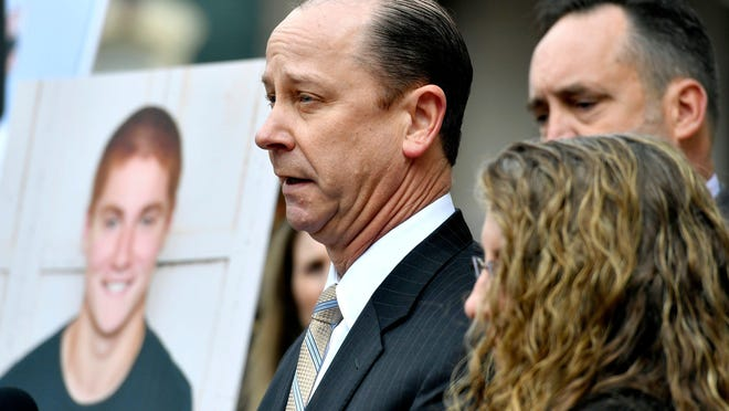 Jim Piazza speaks about the importance of passing the anti-hazing legislation named for his son, Timothy Piazza, Friday outside the courthouse in Bellefonte, Pa.