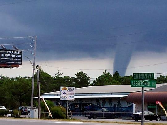 A large waterspout forms near Navarre on Tuesday around 11:30 a.m