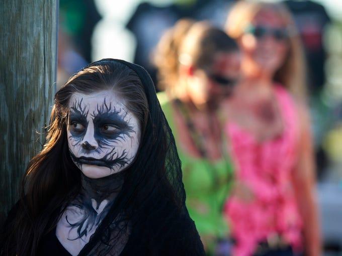 Rachel Martorella, 10, of Miami waits for the zombie