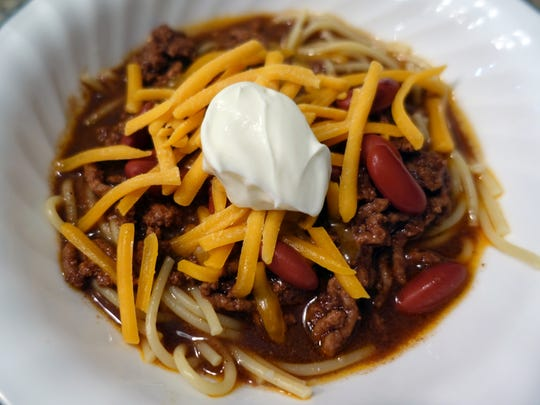 Cincinnati-style chili is served over spaghetti; diners add cheese, beans and/or other toppings as desired.