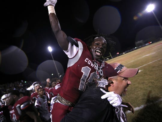 Madison County's Travis Jay celebrates on the sidelines as the Cowboys defeated Pahokee during last year's state semifinals to advance to the state championship game.