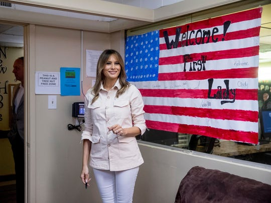 First lady Melania Trump with artwork of an American flag while visiting the Upbring New Hope Children Center in McAllen, Texas, June 21, 2018.