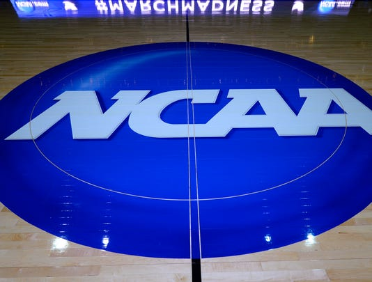 2013-03-30-ncaa-logo-basketball-floor