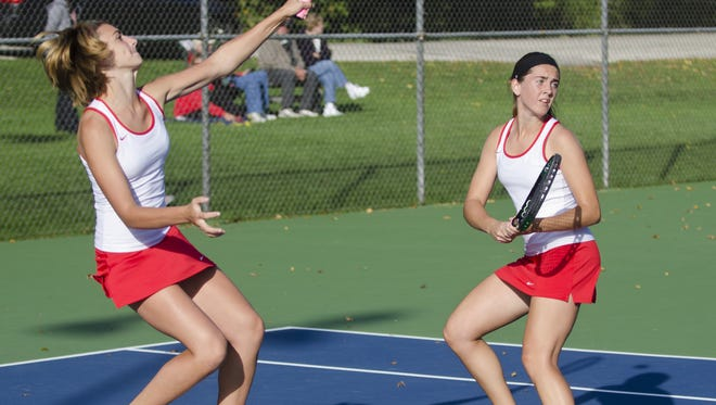 The Manitowoc Lincoln girls tennis team returns just half of it's top 10 players from last year's team including Jen Belisle, right.