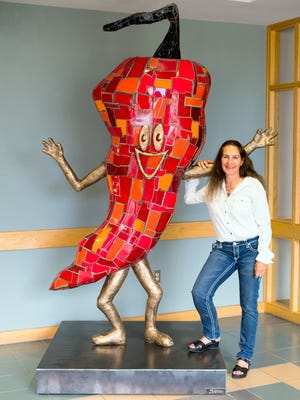 Pictured is artist Linda Joanou with her piece 'Ramel'.