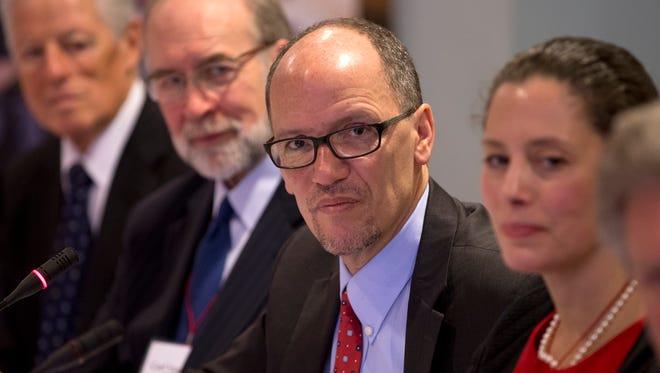 U.S. Secretary of Labor Thomas Perez, center, participates in the New Start Career Network symposium Tuesday in New Brunswick.